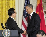 Hu Jintao Photo - RESTRICTED NEW YORKNEW JERSEY OUTNO NEW YORK OR NEW JERSEY NEWSPAPERS WITHIN A 75 MILE RADIUS OF NYCUnited States President Barack Obama and President Hu Jintao of China shake hands following a joint press conference in the East Room of the White House during the State Visit honoring President Hu on Wednesday January 19 2011 Photo by Ron Sachs-CNP-PHOTOlinknet