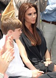 Brooklyn Beckham Photo - Photo by REWestcomstarmaxinccom201152311Victoria Beckham and Brooklyn Beckham at a star ceremony at the Hollywood Walk of Fame(Hollywood CA)