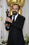 Asghar Farhadi Photo -  EMBARGOED AT THE REQUEST OF THE ACADEMY OF MOTION PICTURE ARTS  SCIENCES FOR USE UPON CONCLUSION OF THE ACADEMY AWARDS TELECAST Asghar Farhadi with the Best Foreign Language Film award received for A Seperation at the 84th Academy Awards at the Kodak Theatre Los Angeles