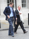 Andrew Neil Photo - Scottish journalist and broadcaster Andrew Neil 61 and British broadcaster and political aide Alastair Campbell have a good chuckle as Alastair fiddles with his earpieces and microphone before recording a brief interview outside of the BBC Broadcasting House  Later the pair leave the building together while chatting London UK 012211