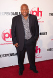 Young MC Photo - Young MC (aka Marvin Young) poses on the red carpet before a special screening of the ensemble action war film The Expendables written by Sylvester Stallone held at the Planet Hollywood Resort and Casino Stallone who seemingly set the standard for muscle bound explosive action flicks has been quoted as saying Usually at my age youre out there fly fishing somewhere in Ireland For me to keep on doing this and prove it can be done Im trying to get the younger guys to step up and try and get these kind of films made because I know they watch them Las Vegas NV 081110