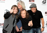 Angus Young Photo - ACDC band members Malcolm Young Cliff Williams Angus Young and Brian Johnson at the ACDC Live at River Plate DVD World Premiere at the HMV Hammersmith Apollo London UK 5611
