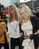 Aly and AJ Photo - Alyson Michalka and Amanda Michalka (also known as Aly  AJ) of the pop band 78violet arrive at the Staples Center to watch the Utah Jazz verses the Los Angeles Lakers basketball game Los Angeles CA 040511