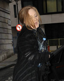 Adele Adkins Photo - Singer Adele (aka Adele Adkins) arrives big water bottle in hand at the studios of BBC Radio where she promoted her upcoming second studio album 21  The Grammy Award winner appeared to have driven herself and gave a modest smile as she walked inside where she performed a live session on the Dermot OLeary show London UK 012211