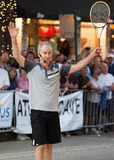 John McEnroe Photo - Former world number one professional tennis player John McEnroe poses with a custom-made sculpture by artist Jeff Wyman that was presented to him prior to his appearance at Tennis on the Ave a friendly tennis exhibition with Mats Wilander in the middle of Atlantic Avenue  McEnroe appeared in good spirits as he smiled and threw his arms in the air while playing in front of spectators who had gathered for the event Delray Beach FL 021811