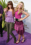Bella Thorne Photo - Bella Thorne and Kathryn Newton pose on the purple carpet after arriving for a special Picnic In The Park premiere of Tinker Bell and the Great Fairy Rescue held at La Cienega Park Los Angeles CA 082810