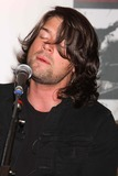 Adam Lazzara Photo - Adam Lazzara of Taking Back Sunday Performing From Their New Album New Again to Celebrate to Launch of New Clothing Brand Dcoded at Macys Herald Square in New York City on 08-16-2009 Photo by Henry Mcgee-Globe Photos Inc 2009
