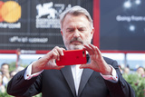 Sam Neill Photo - VENICE ITALY - SEPTEMBER 06 Sam Neill walks the red carpet ahead of the Sweet Country screening during the 74th Venice Film Festival at Sala Grande on September 6 2017 in Venice Italy(Photo by Laurent KoffelImageCollectcom)