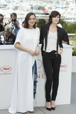 Marion Cotillard Photo - CANNES FRANCE - MAY 17 Actress Marion Cotillard and actress Charlotte Gainsbourg attends the Ismaels Ghosts (Les Fantomes dIsmael) photocall during the 70th annual Cannes Film Festival at Palais des Festivals on May 17 2017 in Cannes France(Photo by Laurent KoffelImageCollectcom)