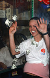 Kris Benson Photo - NEW YORK JANUARY 26 2005    Anna Benson wife of New York Mets pitcher Kris Benson presents the winner of the New York Sports Clubs Theres a Million Reasons to Join Sweepstakes at the New York Sports Club