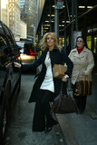 Aliana Lohan Photo - DECEMBER 08 2005 NEW YORK CITY    Naughty Ali Lohan leaves a building in midtown Manhattan and slams the door on her mother Dina who was following close behind much to Dinas surprise and embarrassement