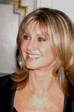 Olivia Newton-John Photo - New York November 11 2004 Olivia Newton-John at One World One Child Benefit at the Plaza