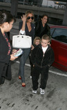 Brooklyn Beckham Photo - Fashion icon and former spice girl Victoria Beckham shephards her sons Brooklyn (R) and Romeo into JFK Airport enroute to LA