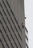 Alain Robert Photo - Several hours after Alain Robert a French stuntman climbed 52 stories up the exterior of the New York Times building and was arrested by police a second man scaled the building on the southwestern corner facing West 40th Street He reached the roof at around 638 pm and was arrested by firefighters and police officers