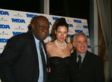 Cal Ramsey Photo - NY Knick CAL RAMSEY Model CAROL ALT and UPN-9 News reporter RUSS SALZBERG attending Muscular Dystrophy Associations Muscle Team Gala  Benefit at Pier Sixty in New York January 2003