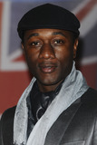 Aloe Blacc Photo - Aloe Blacc arriving for the Brit Awards 2012 at the O2 arena Greenwich London 21022012 Picture by Steve Vas  Featureflash