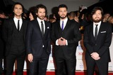 Howard Charles Photo - Luke Pasqualino Santiago Cabrera Howard Charles and Tom Burkearrives for the National TV Awards 2014 at the O2 arena Greenwich London22012014 Picture by Steve Vas