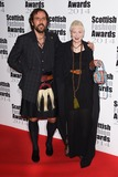 Andreas Kronthaler Photo - Andreas Kronthaler and Dame Vivienne Westwood at the Scottish Fashion awards 2014 at No8 Northumberland Avenue London 01092014 Picture by Steve Vas  Featureflash