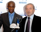 Sir Alan Sugar Photo - London Sir Alan Sugar and Tim Campbell (stars of BBC 2s The Apprentice and winner of the first series)attend the launch of Amstrads latest innovation in the health and beauty industry-INTEGRA at Energy Clinic on Commercial Street20 September 2005Ali KadinskyLandmark Media