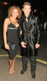 Aret Komlosy Photo - LondonLee Ryan from pop group Blue and escort Aret Komlosy   at the Versace store relaunch party and after dinner party held at Locanda Localli restaurant in London 19th September 2005 FlashburstLandmark Media