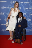 Ade Adepitan Photo - London UK Linda Harrison and Ade Adepitan  at National Lottery Awards 2019 held at BBC Wood Lane London on October 15th 2019Ref LMK73-J5616-161019Keith MayhewLandmark MediaWWWLMKMEDIACOM