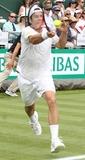 Jo Wilfried Tsonga Photo - London UK Tommy Haas playing against  Jo Wilfried Tsonga at BNP Paribas Tennis Classic at Hurlingham Club London 19th June 2013Ref LMK73-44503-200613Keith MayhewLandmark Media WWWLMKMEDIACOM