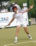 Alistair McGowan Photo - Wimbledon Alistair McGowan dressed as John McEnroe circa early eighties playing against Tim Henman at Tim Henmans Ariel Tennis Ace search at Wimbledon14 June 2004PAULO PIREZLANDMARK MEDIA