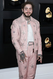 Angel City Photo - LOS ANGELES CA USA - FEBRUARY 10 Rapper Post Malone wearing a custom pink Ashton Michael suit designed by Catherine Hahn studded by Star Studded a Tom Ford tank Scott Wayne boots a BB Simon belt and bracelet and Angel City Jewelers diamonds arrives at the 61st Annual GRAMMY Awards held at Staples Center on February 10 2019 in Los Angeles California United States (Photo by Xavier CollinImage Press Agency)