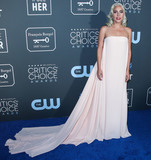 Calvin Klein Photo - SANTA MONICA LOS ANGELES CA USA - JANUARY 13 Actresssinger Lady Gaga  (Stefani Joanne Angelina Germanotta) wearing a Calvin Klein By Appointment dress Giuseppe Zanotti shoes and Djula earrings arrives at the 24th Annual Critics Choice Awards held at the Barker Hangar on January 13 2019 in Santa Monica Los Angeles California United States (Photo by Xavier CollinImage Press Agency)