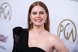 Amy Adams Photo - BEVERLY HILLS LOS ANGELES CA USA - JANUARY 19 Actress Amy Adams wearing a Dundas dress Jimmy Choo shoes and Cartier jewelry while carrying a William and Son clutch arrives at the 30th Annual Producers Guild Awards held at The Beverly Hilton Hotel on January 19 2019 in Beverly Hills Los Angeles California United States (Photo by Xavier CollinImage Press Agency)
