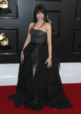 Camila Cabello Photo - LOS ANGELES CALIFORNIA USA - JANUARY 26 Singer Camila Cabello wearing a Versace dress and shoes with Le Vian jewelry arrives at the 62nd Annual GRAMMY Awards held at Staples Center on January 26 2020 in Los Angeles California United States (Photo by Xavier CollinImage Press Agency)