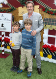 Four Seasons Photo - BEVERLY HILLS LOS ANGELES CA USA - DECEMBER 09 Actor Sam Trammell with children Gus Trammell and Winston Trammell arrive at the Brooks Brothers Annual Holiday Celebration In Los Angeles To Benefit St Jude 2018 held at the Beverly Wilshire Four Seasons Hotel on December 9 2018 in Beverly Hills Los Angeles California United States (Photo by Xavier CollinImage Press Agency)