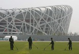 ARMED POLICE Photo - Apr 14 2008 Beijing China the Armed Police Who Received Special Training For the Olympic Games Clean the Lawn in Front of the National Stadium Also Known As Birds Nest Photo by Top Photo-Globe Photos Inc