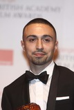 Adam Deacon Photo - Actor Adam Deacon Poses in the Winners Photo Room During the British Academy Film Awards at Royal Opera House in London Great Britain on 12 February 2012 Photo Alec Michael - Globe Photos