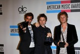 Christopher Wolstenholme Photo - The band Muse Christopher Wolstenholme (l-r) Matthew Bellamy and Dominic Howard pose with their awards for alternative rock music favorite artist in the press room of the 2010 American Music Awards at Nokia Thetare LA Live in Los Angeles USA on november 21st 2010 Photo Alec Michael-Globe Photos Inc 2010K66854AM