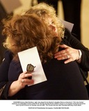 Carroll OConnor Photo - K22223MRActress Sally Struthers right who played Archie Bunkers daughter Gloria on televisions All in the Family embraces an unidentified woman inside the St Paul the Apostle Roman Catholic Church in Los Angeles during the funeral for actor Carroll OConnor on Tuesday June 26 2001  The 76-year-old actor died Thursday following a heart attack PHOTO BY AP PhotoDamian Dovarganes PoolGLOBE PHOTOSINC
