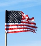 American Flag Photo - American Flag Blowing in Wind with Shredded Stripesthe Shredded American Dream