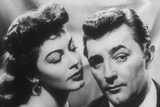 Ava Gardner Photo - Robert Mitchum with Ava Gardner in My Forbidden Past Supplied by Globe Photos Inc Tv-film-still