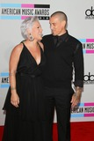 Alecia Moore Photo - Singer Pink and Her Husband Carey Hart the 2010 American Music Awards Red Carpet Arrivals Held at Nokia Theatre in Los Angeles California on November 21 2010 Photo by Alec Michael-Globe Photos Inc K66963am Pink Aka Alecia Moore