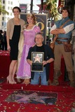 Alan Menken Photo - Composer Alan Menken Honored with Star on the Hollywood Walk of Fame El Capitan Theatre Hollywood CA 11102010 Mandy Moore and Alan Menken Posing with Rapunzel and Flynn Photo Clinton H Wallace-photomundo-Globe Photos Inc 2010