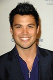 Michael Copon Photo - Michael Copon attends the 8th Annual Operation Smile Gala Held at the Beverly Hilton Hotel in Beverly Hills California on October 2 2009 Photo by David Longendyke-Globe Photos Inc 2009