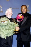 Caroll Spinney Photo - 33rd Annual Daytime Emmy Awards Kodak Theatre Hollywood California 04-28-2006 Photo Hakim  Globe Photos Inc 2006 Caroll Spinney with Oscar the Grouch and Kevin Clash and Elmo (Sesame Street)