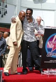 Ike Turner Photo - - Director John Singleton Honored with Star on the Hollywood Walk of Fame - Hollywood Blvd Hollywood CA - 08262003 - Photo by Clinton H Wallace  Ipol  Globe Photos Inc 2003 John Singleton and Ike Turner