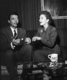 Anne Baxter Photo - Gregory Peck Anne Baxter Backstage at Lux Radio Theater Photo Nate CutlerGlobe Photos Inc