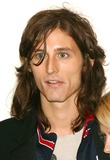 Nick Valensi Photo - The Opening Reception For Anton Corbins Exhibit of U2 Photos at the Stellan Holm Gallery New York City 10-09-2005 Photo by John Zissel-ipol-Globe Photos 2005 Nick Valensi of the Strokes