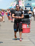 Mike The Situation Sorrentino Photo - August 3 2010 Mike The Situation  Sorrentino gets some food on the boardwalk as they film scenes for season 3 of the Jersey Shore in Seaside Heights New Jersey